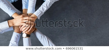 close up of business team stacking hands Stock photo © dolgachov