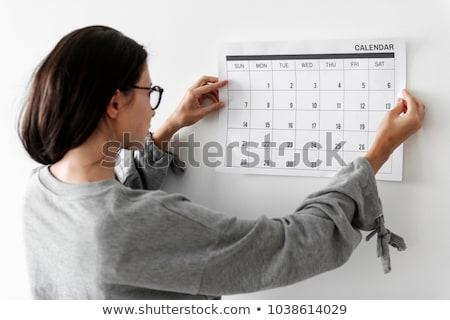 Checking timetable in planner Stock photo © pressmaster