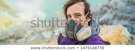 BANNER, LONG FORMAT Young man tourist makes a selfie standing at the edge of the crater of the Ijen  Stock photo © galitskaya