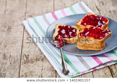 Fresh toasted cereal bread slices with homemade cherry jam and s Stock photo © marylooo