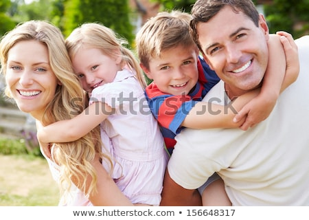 Stockfoto: Family Piggyback Mum Carrying Child On Shoulders