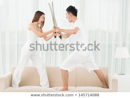 Swordstress female with sword Stock photo © lovleah