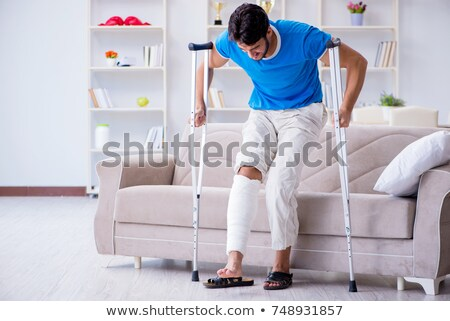 injured man in a wheelchair stock photo © rtimages