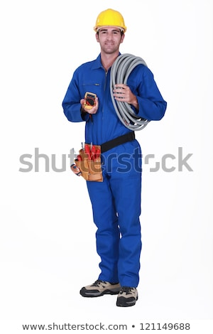 tradesman holding his tools and corrugated tubing stock photo © photography33