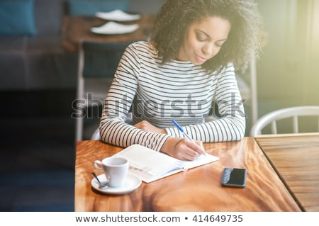 Businesswoman writing in journal Stock photo © photography33