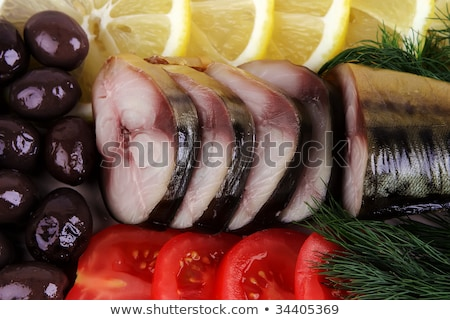 Stock photo: slices smoked fish served with tomato and olive