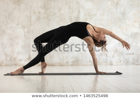 Graceful woman stretching doing yoga Stock photo © dash