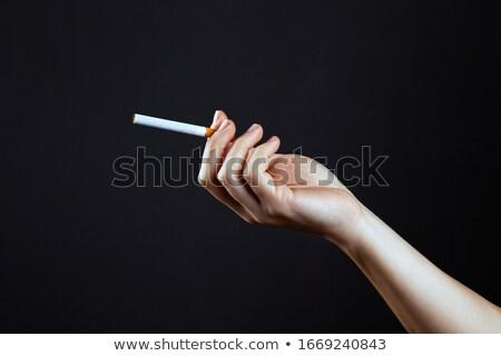 Mão cigarro mãos terapia cigarros Foto stock © ozaiachin