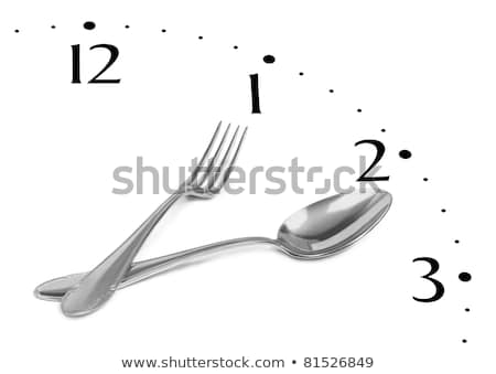 clock made of spoon and fork isolated on white background stock photo © shutswis