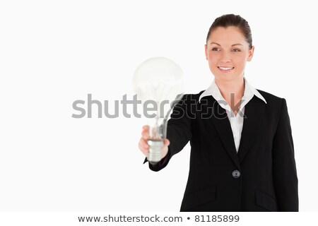 fókuszált · nő · villanykörte · gyönyörű · tart · izolált - stock fotó © wavebreak_media