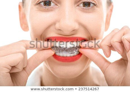 Closeup portrait of charming woman wearing orthodontic braces ho Stock photo © HASLOO