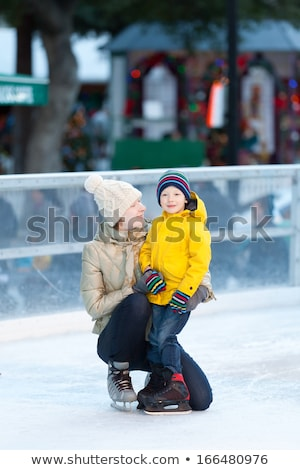 Happy hocky Mom cheering her child Stock photo © antonbrand