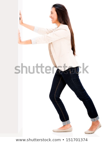 Woman pushing or leaning on wall Stock photo © elwynn