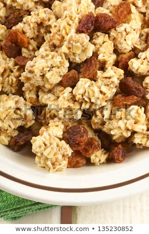 Crunchy oat clusters with raisins closeup Stock photo © aladin66