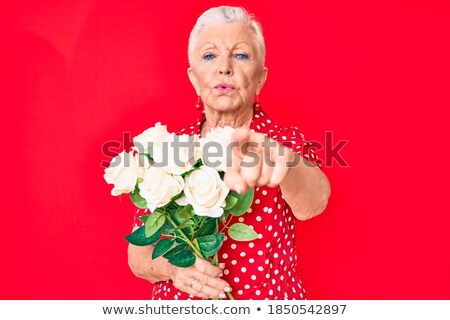 beauty woman looks at you with roses in hand stock photo © feedough