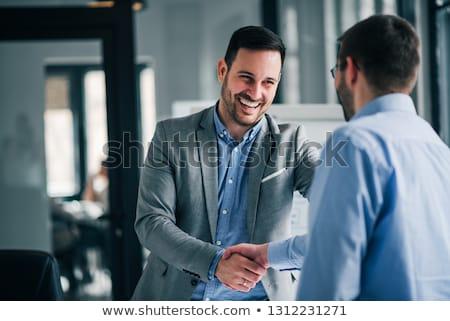 Biznesmen handshake działalności strony tle mężczyzn Zdjęcia stock © pinkblue