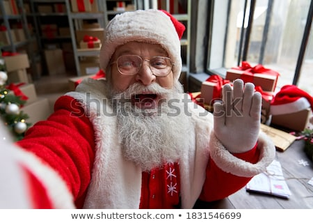 portrait of happy santa claus calling phone stock photo © hasloo