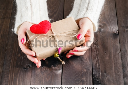 woman holding heart and giftbox stock photo © chesterf