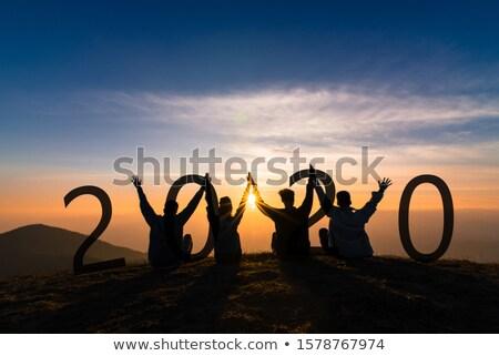 grupo · jovens · saltando · ao · ar · livre · grama · feliz - foto stock © ongap