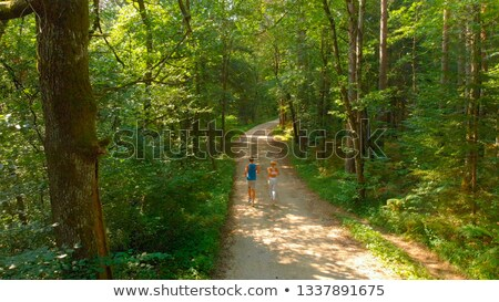 小さな フィット 女性 を実行して ダウン 砂利道 ストックフォト © sumners