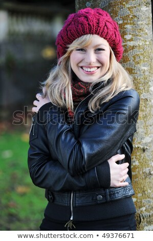 Stock photo: Blonde real woman smiling in black leather jacket