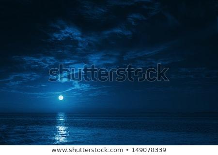 Hold felhők éjszakai ég naplemente kék napfelkelte Stock fotó © FOKA