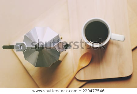 hot coffee and moka pot with wooden spoon retro filter effect stock photo © happydancing