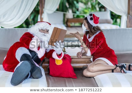mrs claus with gift on beach Stock photo © ssuaphoto