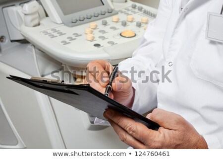 Hand with pen writing Physical Therapy Stock photo © Zerbor
