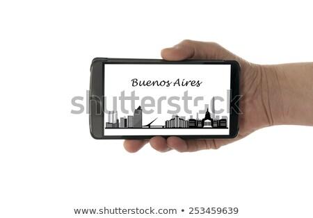 Női kéz mobiltelefon Buenos Aires sziluett izolált Stock fotó © compuinfoto