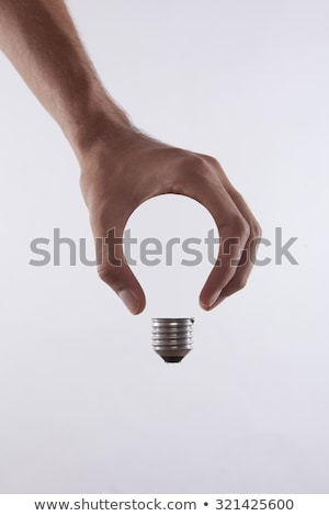 creative bulb in hands stock photo © vgarts