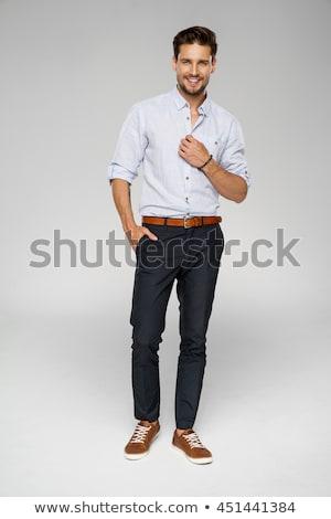 fiatal · jóképű · férfi · pózol · kalap · áll · fehér - stock fotó © neonshot