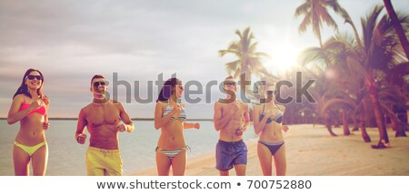 woman at sunset over the ocean with tropical palm trees stock photo © ankarb