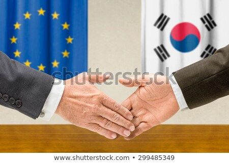 Representatives of the EU and South Korea shake hands Stock photo © Zerbor