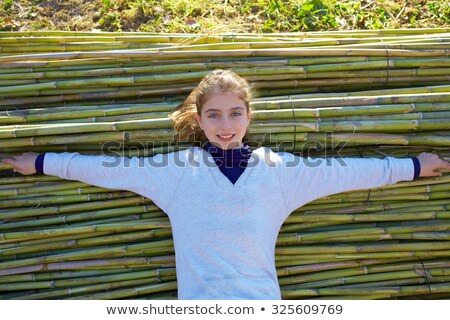 Stock photo: Kid girl relaxed in green canes background