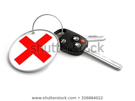 car keys with declined cross symbol on key ring concept for dec stock photo © crashtackle