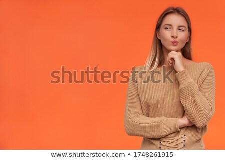 Kadın poz ayakta dokunmak çene güzel bir kadın Stok fotoğraf © feedough