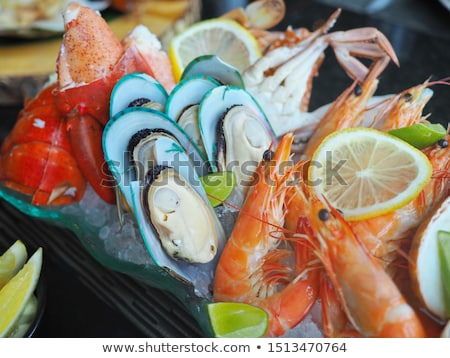 Stock photo: Buffet table with seafood with shrimps and  mussels