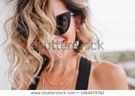 fashion portrait of beautiful tanned woman with blond hair in el Stock photo © Victoria_Andreas