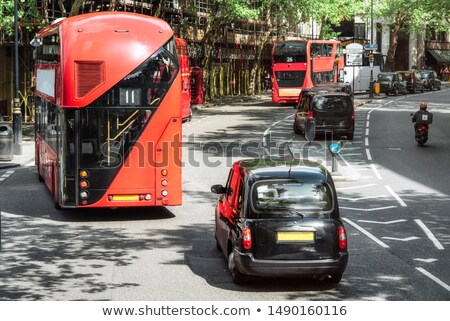 Symbols of London, the UK. Red buses, black taxi cab. Black and white Stock photo © photocreo