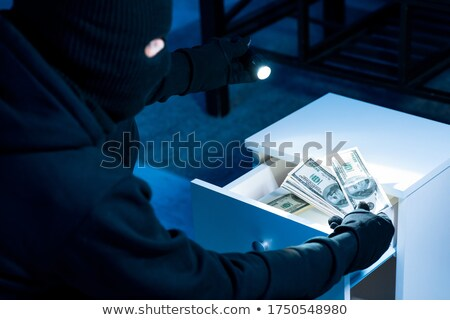 Portrait of man criminal burglar using crowbar Stock photo © deandrobot