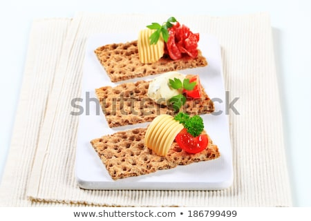 Whole grain crispbread with various toppings Stock photo © Digifoodstock