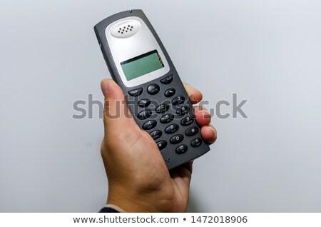 Female hand holding cordless landline telephone receiver outdoor Stock photo © stevanovicigor