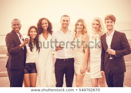 portrait of well dressed people posing next to limousine stock photo © wavebreak_media