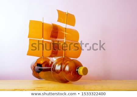Modèle ordures navire monde coucher du soleil monde Photo stock © sebikus