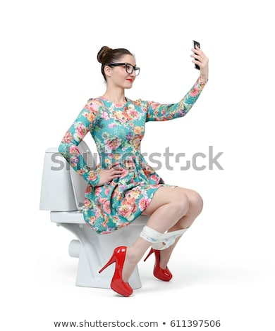 woman sits on toilet bowl stock photo © ssuaphoto