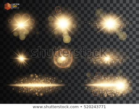 set of golden glitters lights and sparkles with lens effect on t Stock photo © SArts