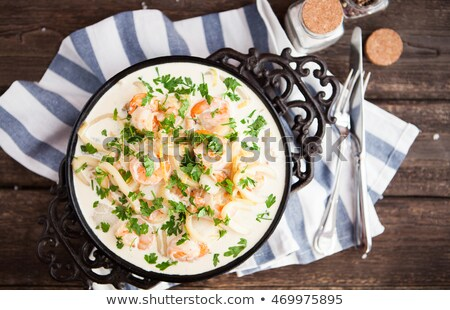 seafood   shrimp and squid with white cream sauce on frying pa stock photo © yatsenko