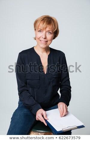 olgun · kadın · oturma · poz · yalıtılmış · görüntü - stok fotoğraf © deandrobot