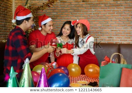 vijf · vrienden · champagne · geschenken · woonkamer · glimlachend - stockfoto © monkey_business